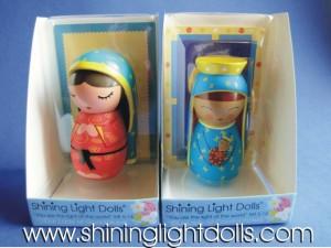 shining light dolls in boxes