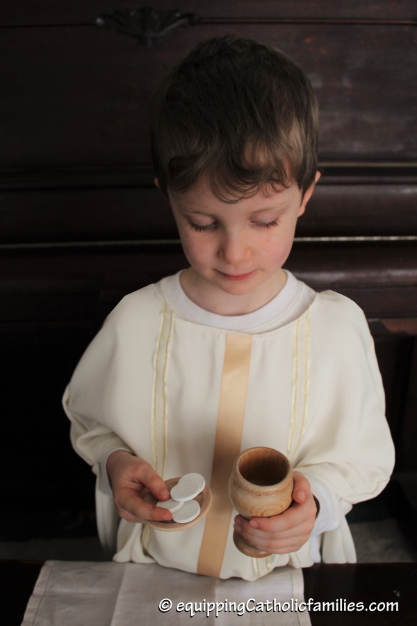 child chasuble play priest